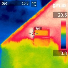 thermal image showing heat loss from house